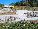 Utwardzanie terenu - wjazdu na przyszłą budowę.